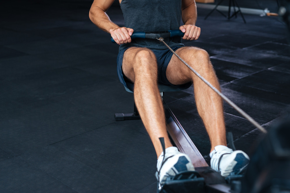 Cropped portrait of fitness man doing exercise. Exercise for your hands