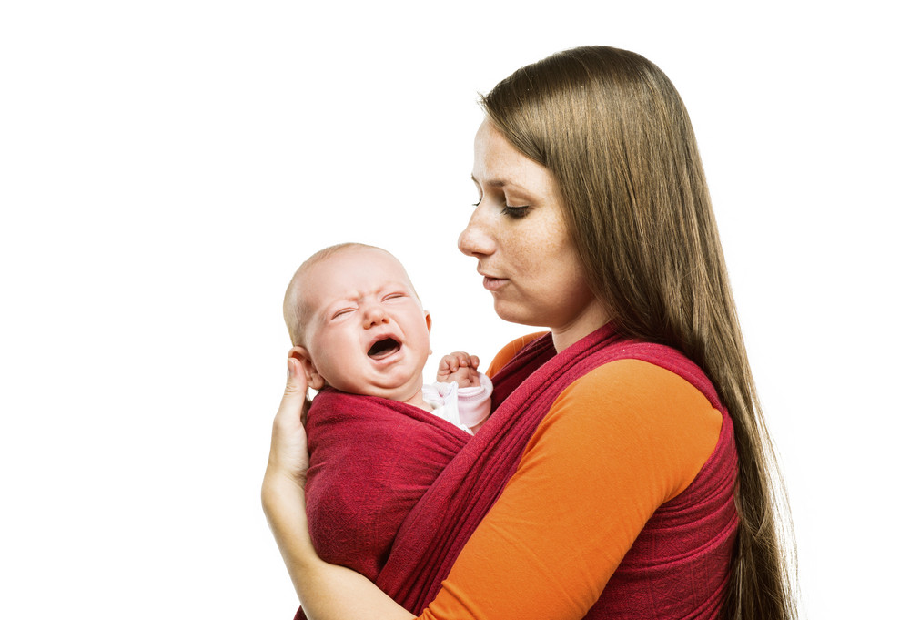 Crying child with mother isolated on white background in studio