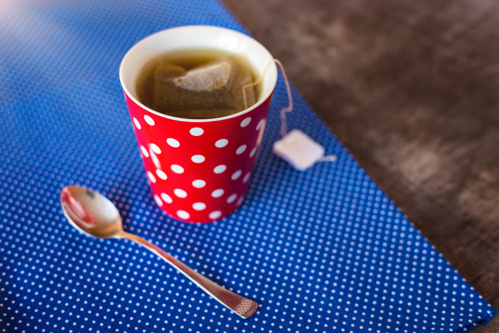 Cup of tea on a wooden table background