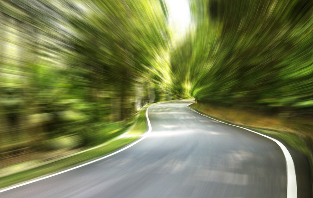Curve way of asphalt road in the green view.,Motion blurred background