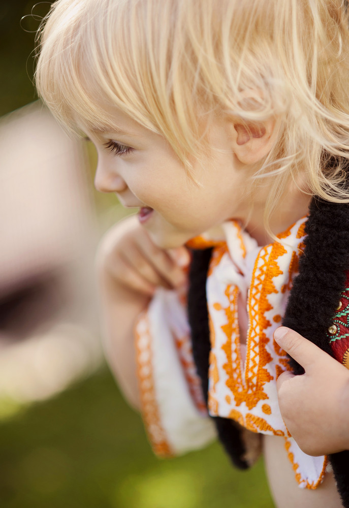 Cute child in folk costume from Easten Europe.