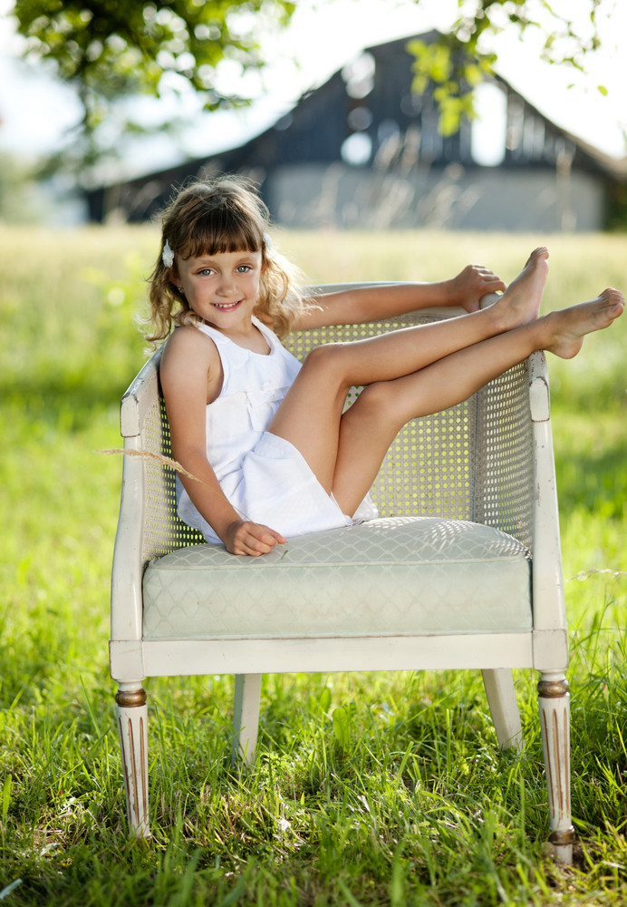 Cute little girl is enjoying leisure time with in green sunny park