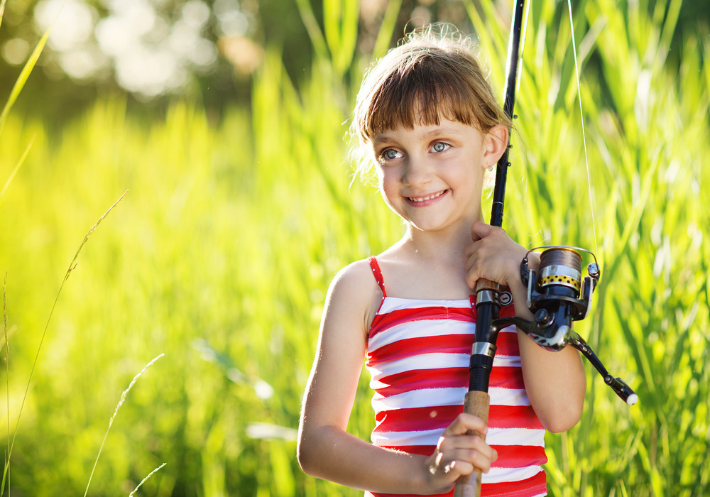 Cute little girl is ready to go fishing