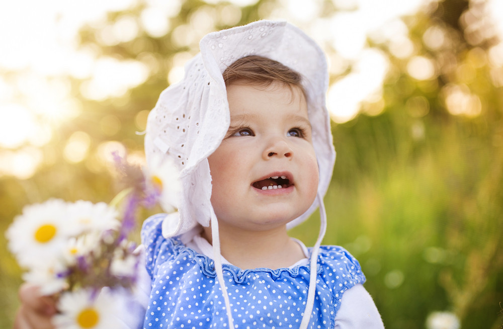 Cute little girl outside in nature on a summer day