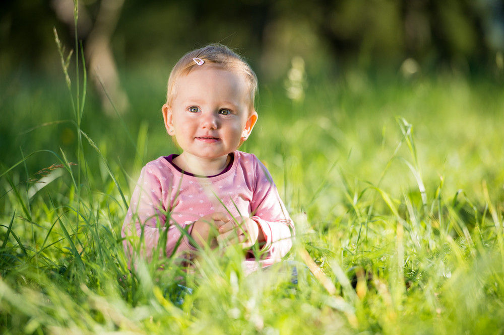 Cute little girl outside in nature on a sunny day