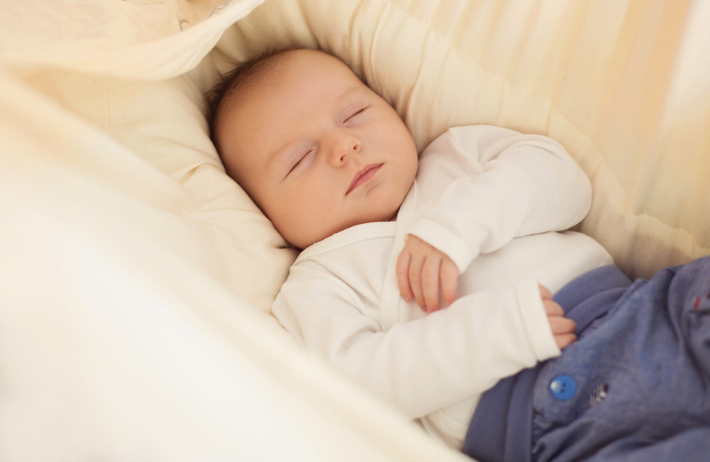 Cute newborn baby boy relaxing at home
