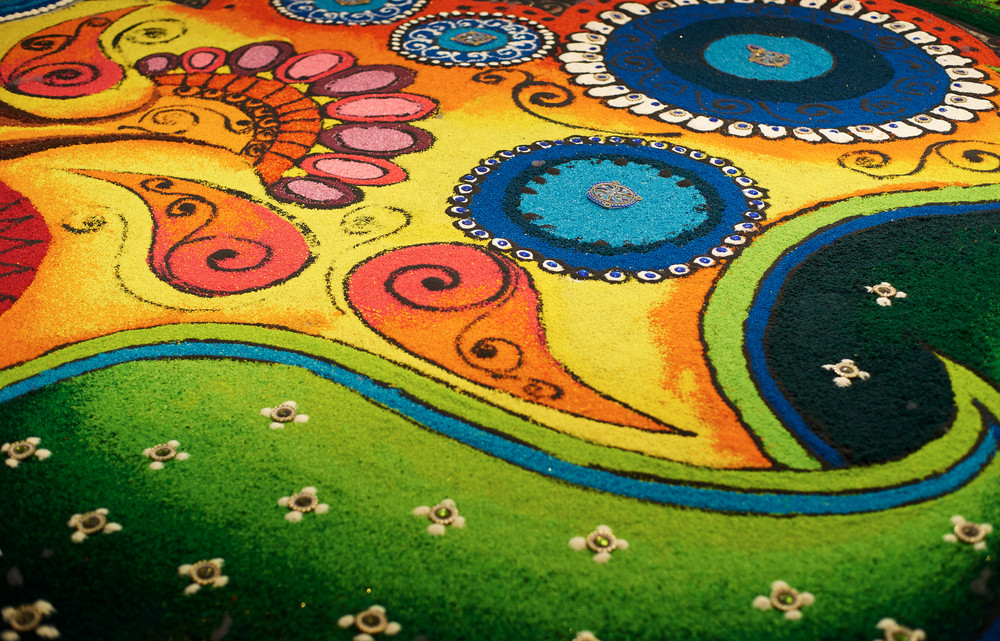 Deepak with colourful rangoli