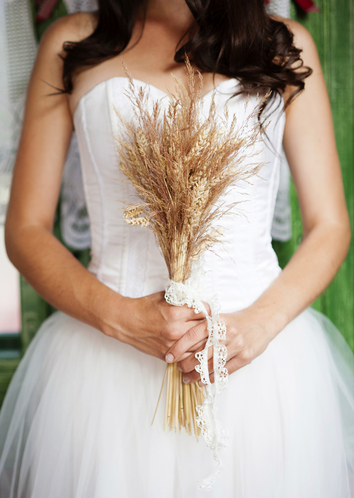 Detail of beautiful bridal dress in countryside