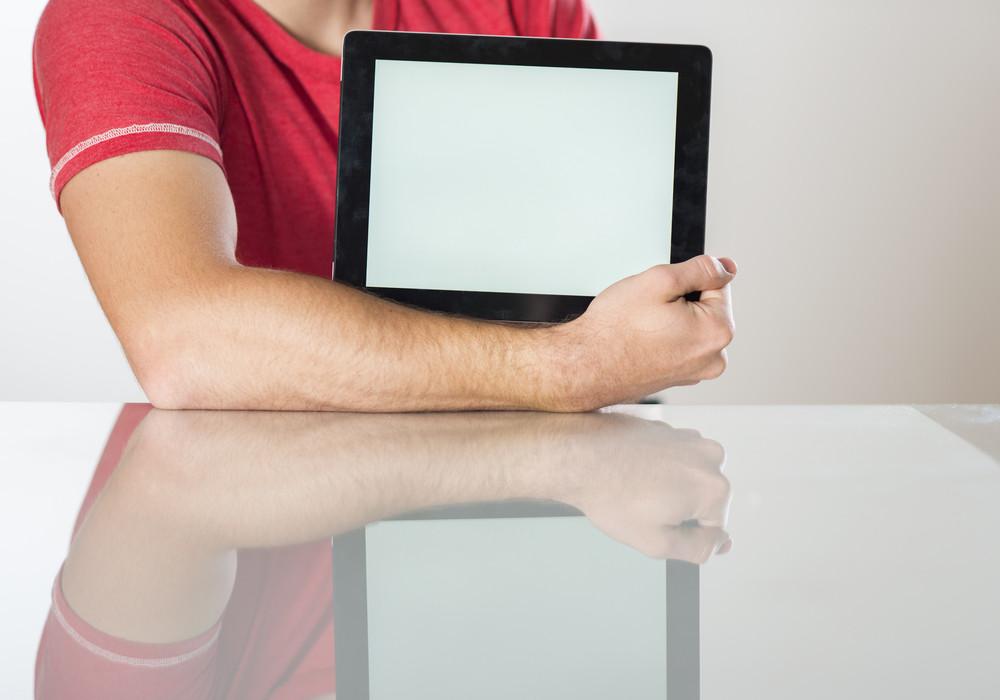 Detail of hands with tablet computer in studio