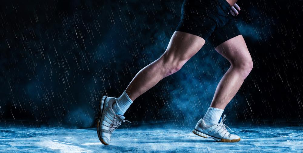 Detail of runne feet running in misty dark