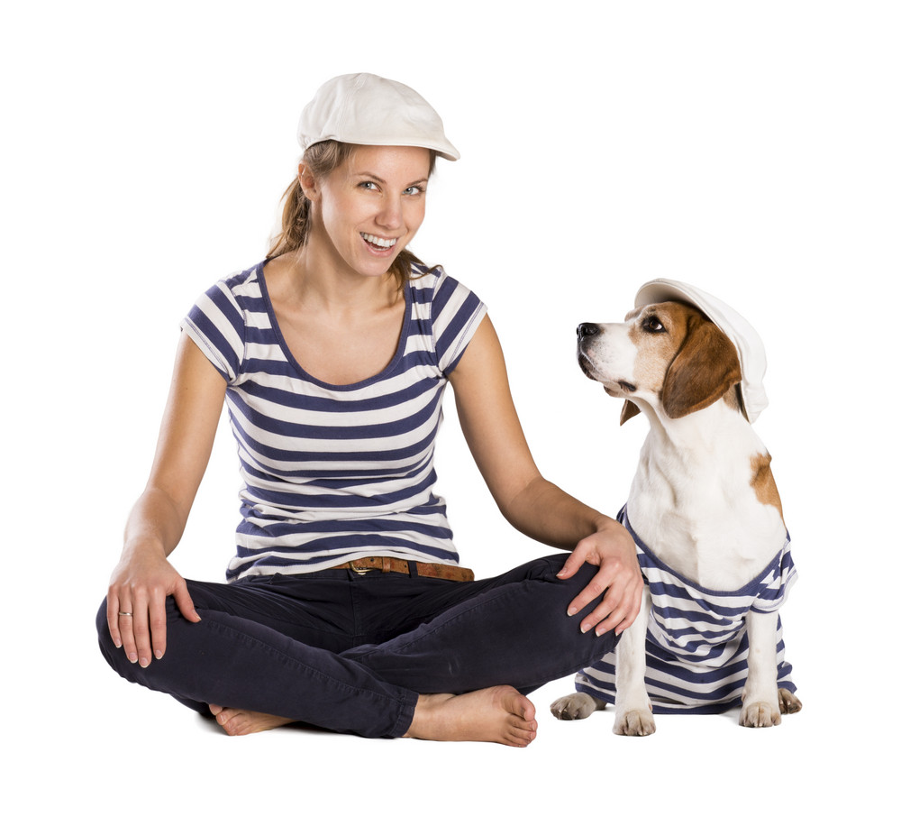 Dog with woman are posing in studio - isolated on white background