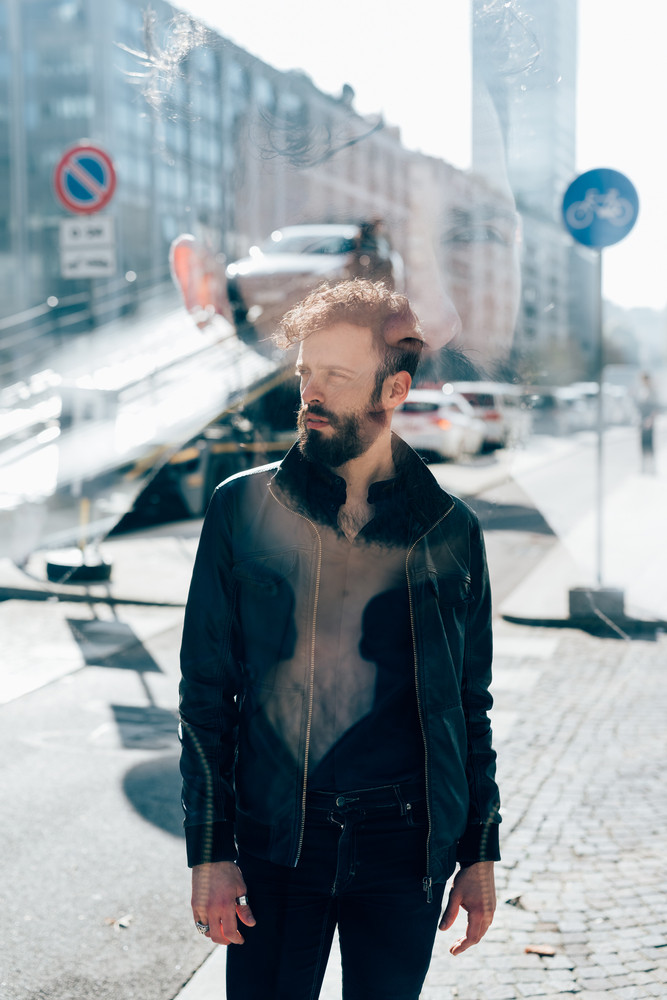 Double exposure of young caucasian bearded man outdoor overlooking pensive - creative, pensive, serious concept