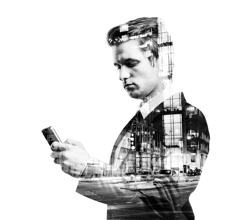 Double exposure of young hipster businessman with smart phone.