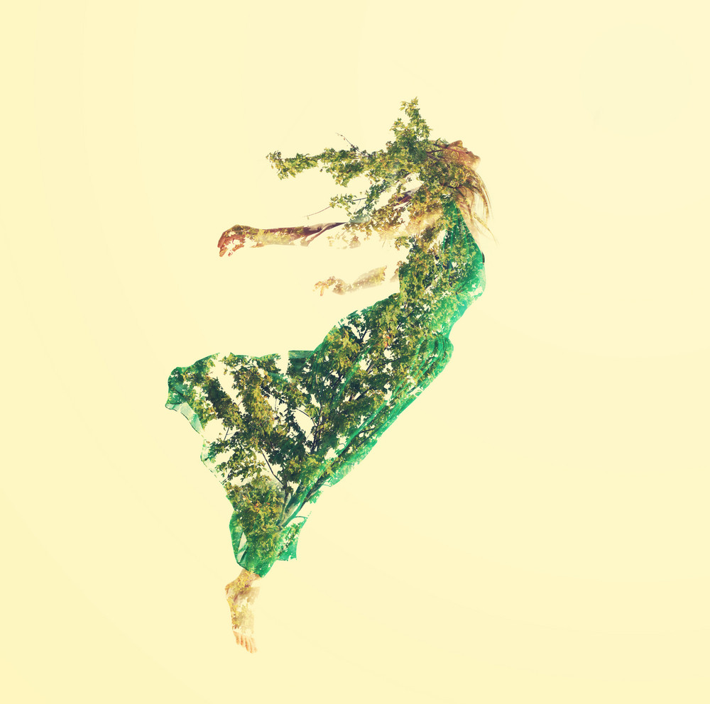 Double exposure of young woman flying with abstract leaves