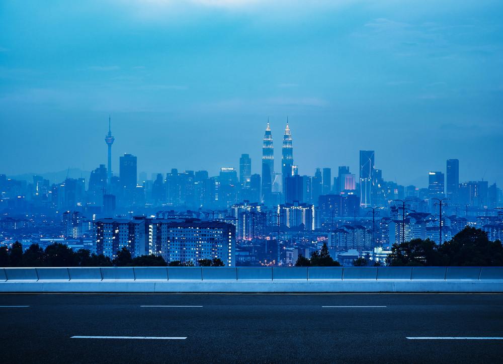 empty asphalt road and cityscape skyline , night scene scene