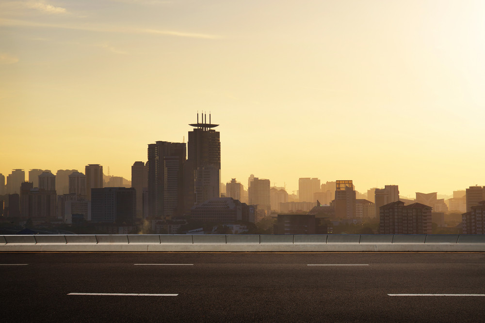 empty asphalt road and cityscape skyline,evening scene