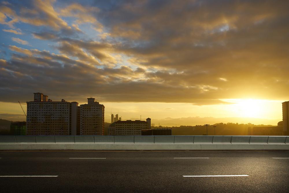 empty asphalt road and cityscape skyline,sunrise scene