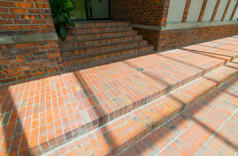 Empty brick floor with modern building in Kuala Lumpur .
