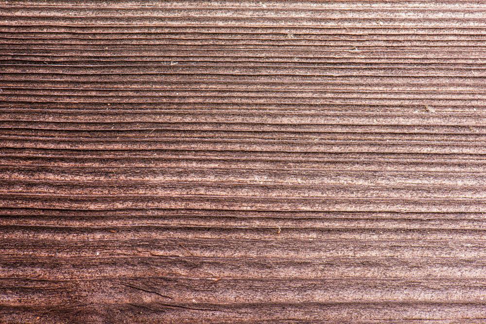 Empty brown wooden background with texture. Studio shot.