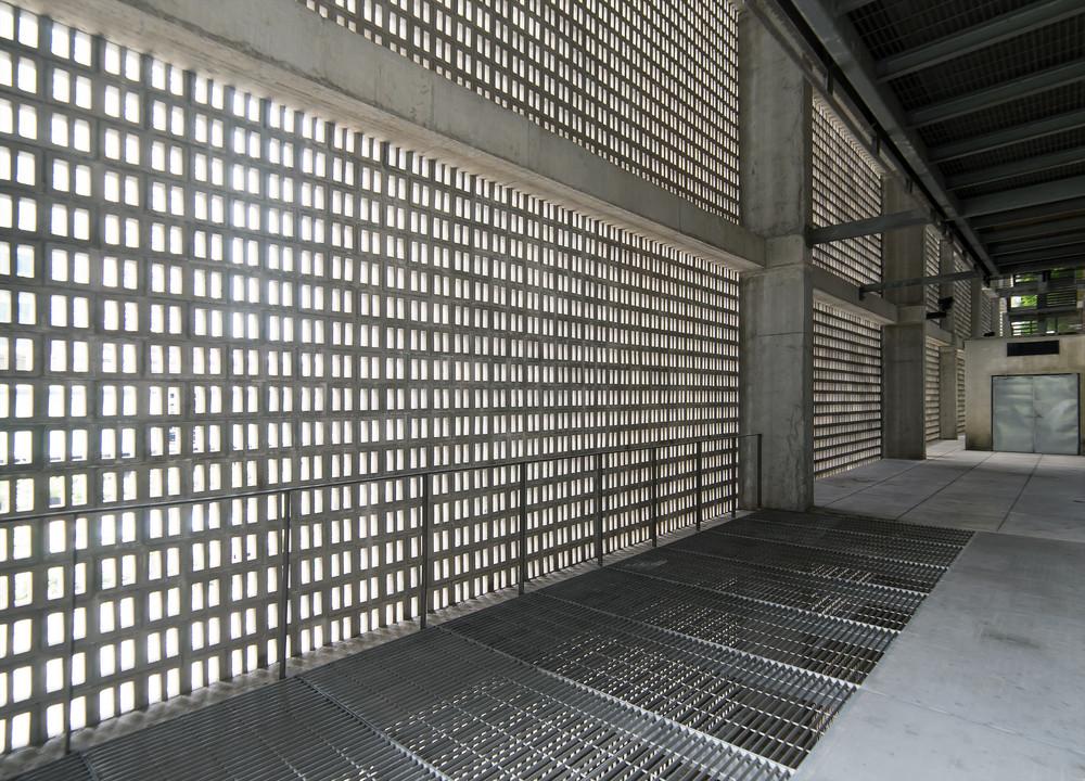 Empty gray concrete corridor