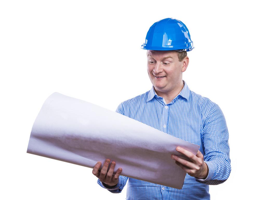 Engineer in blue hard hat holding a blueprint. Studio shot on white background.