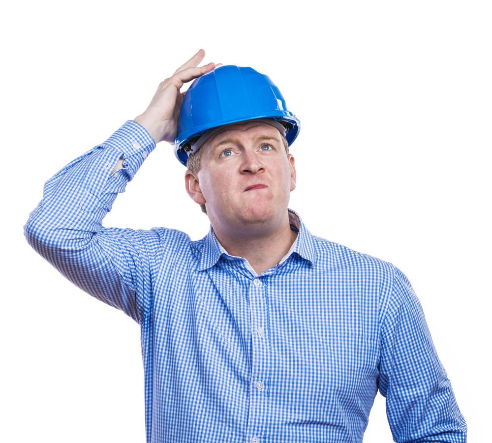 Engineer in blue hard hat. Studio shot on white background.