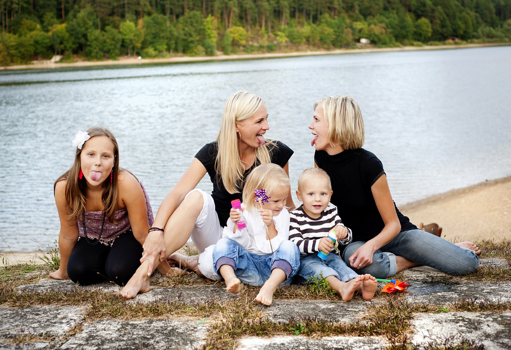 Family time by the lake in summer time