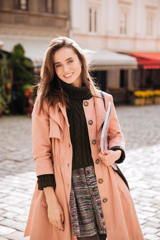 Fashion model in coat looking at camera