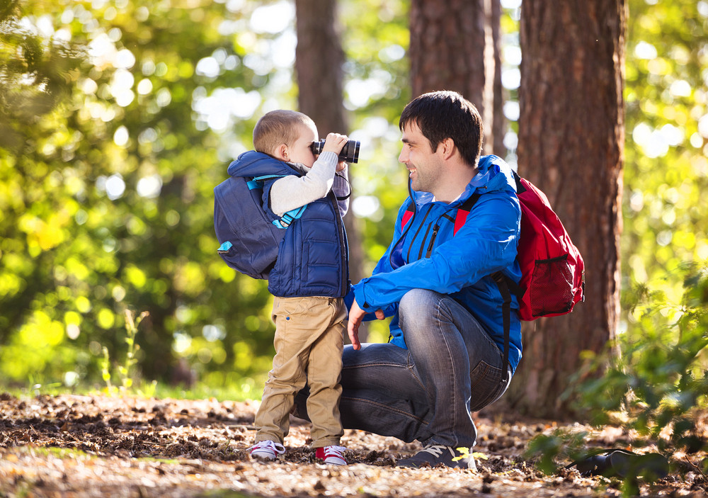 Father and son enjoying a walk in the forest