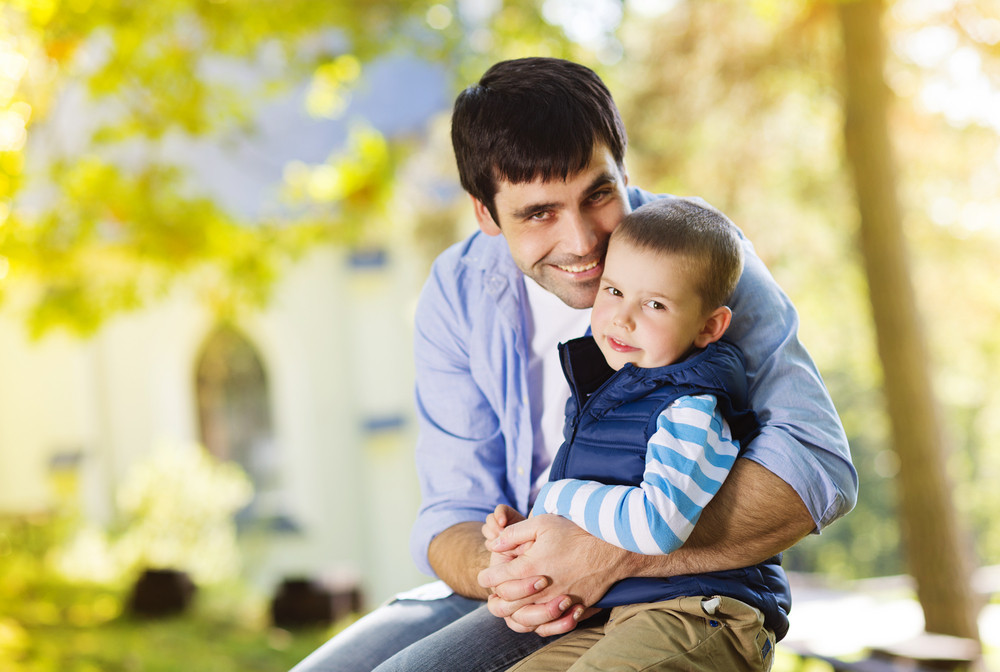 Father and son spending time together in summer nature