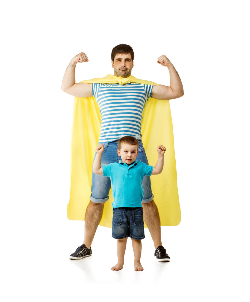 Father as hero with his son isolated on white background