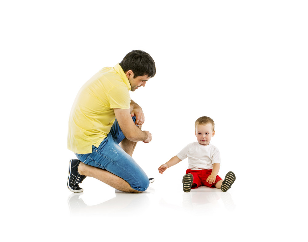 Father playing with his son isolated on white background
