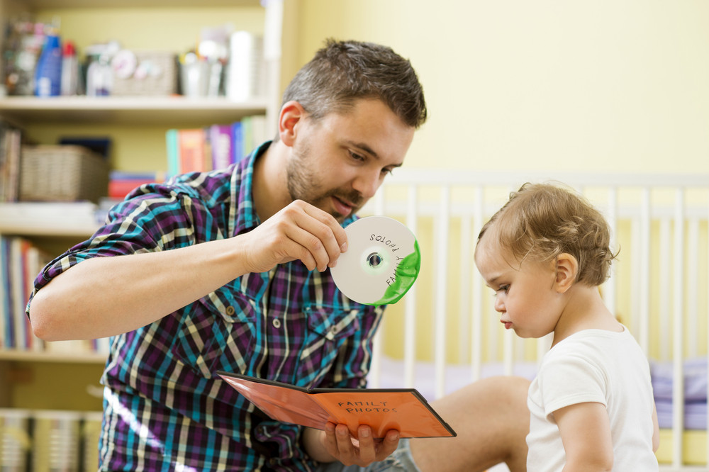 Father with damaged CD and his little daughter