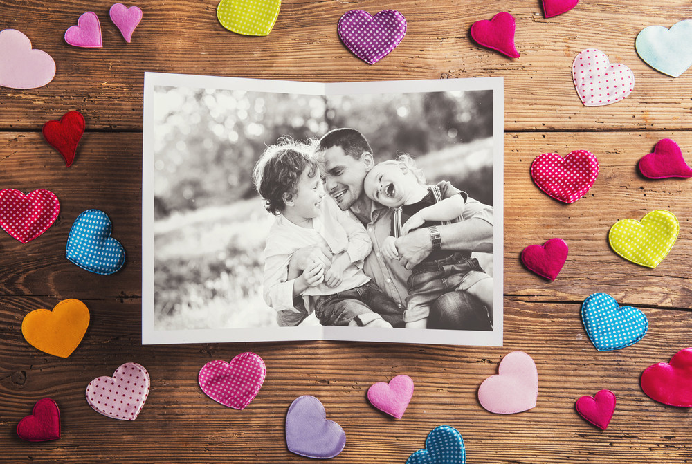 Fathers day composition - textile hearts on the floor. Studio shot on wooden background.