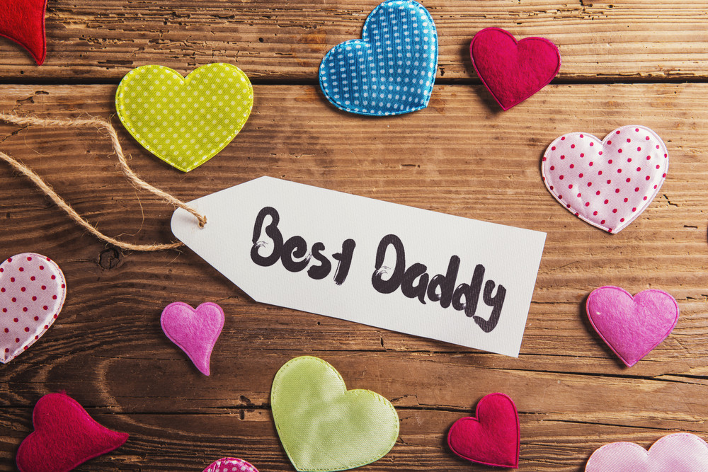 Fathers day composition with fabric hearts. Studio shot on wooden background.