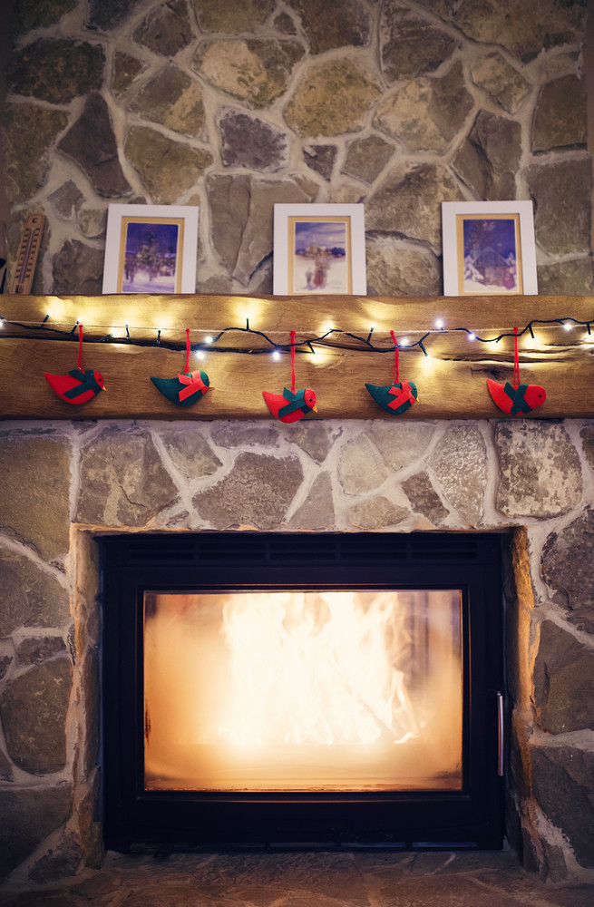 Fireplace with christmas decorations and a light chain