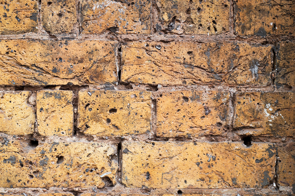Fragment of an old brick wall background.