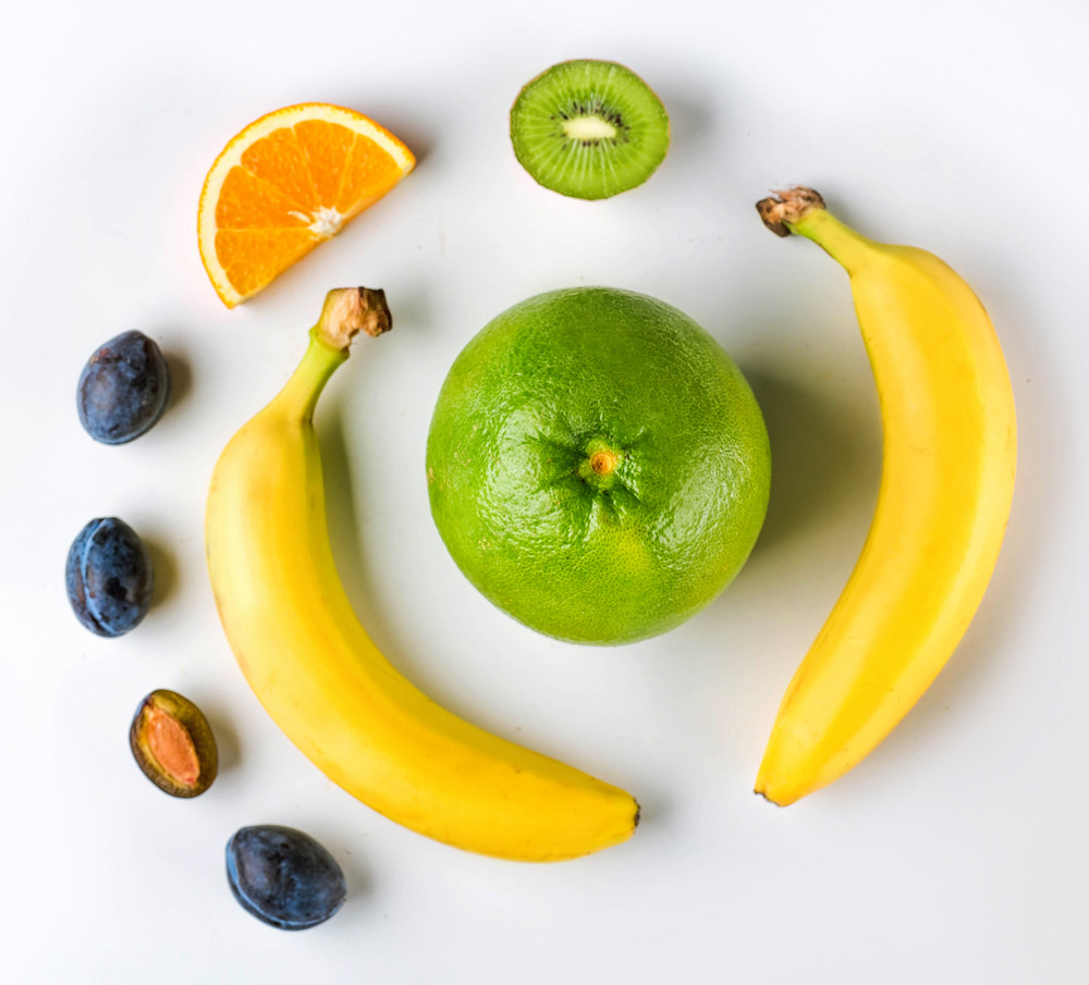 Fresh fruits on white background. Healthy food concept