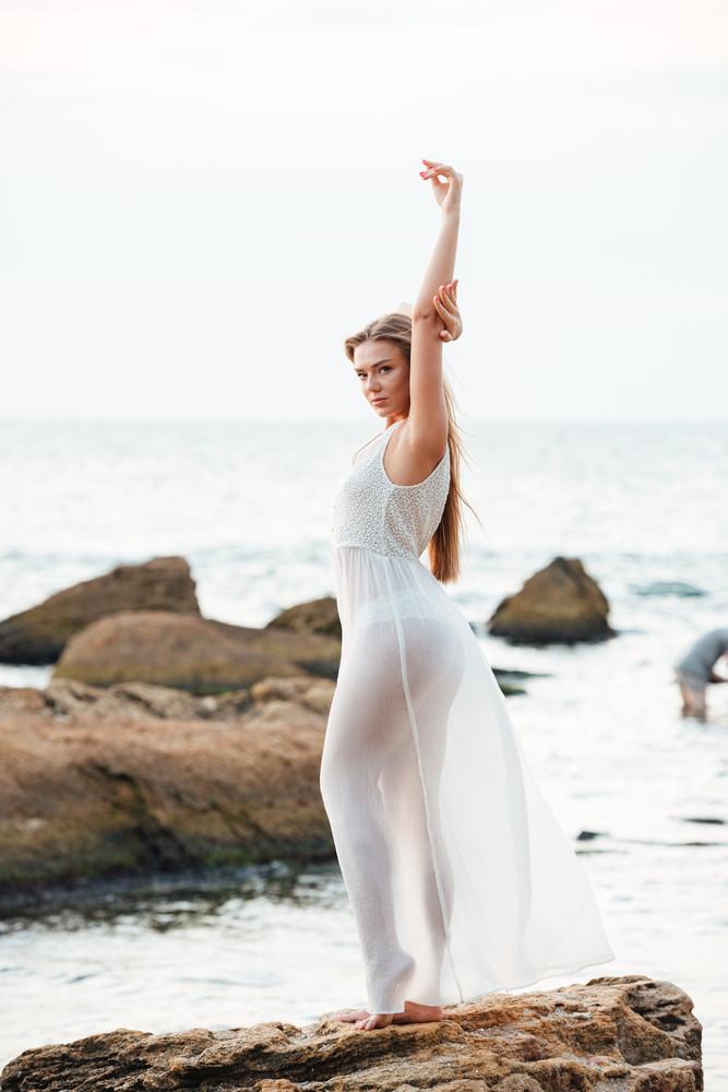 Full length beauty model on the beach. so pretty portrait