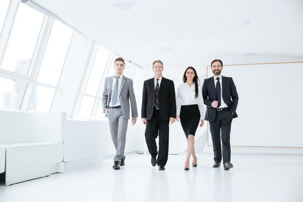 Full length Confident Business team walk in office