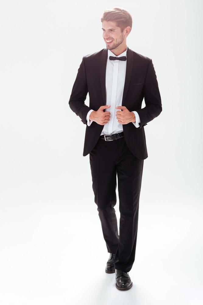 Full length model in suit. white background