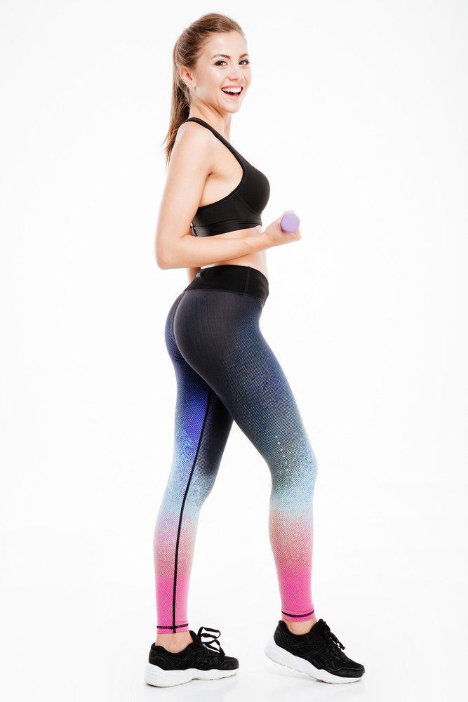 Full Length Portrait Of A Fitness Woman Workout With