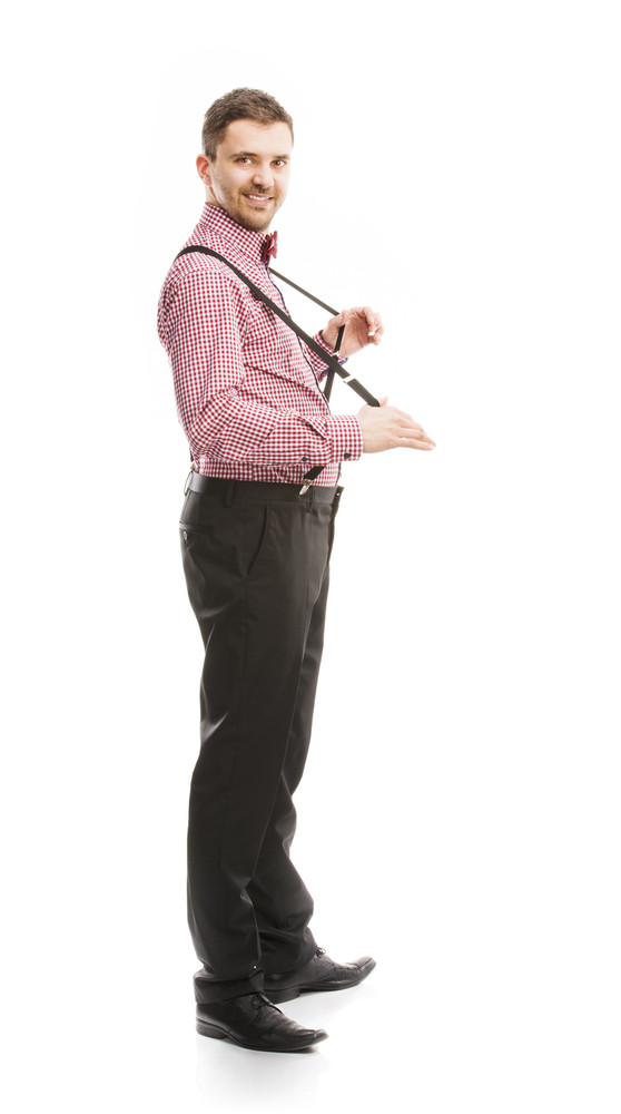 Funny business man is posing in studio with bow tie and braces