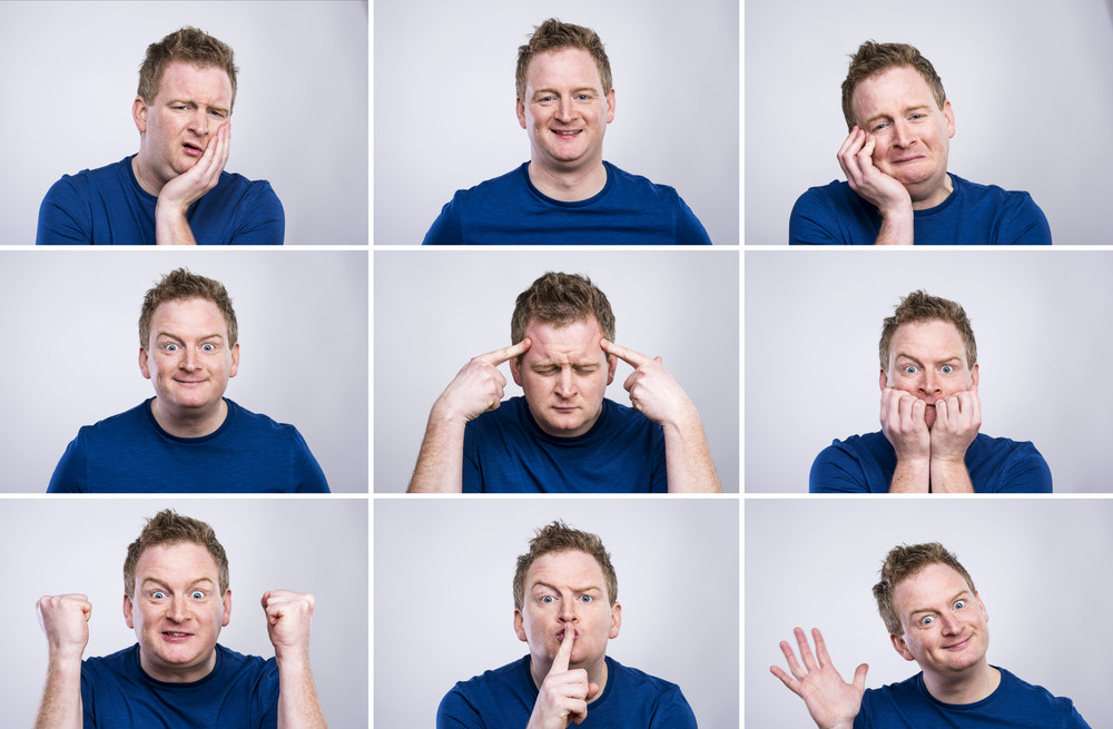 Funny young adult showing his emotions expressively by his gestures and mimics . Studio shot on white background.
