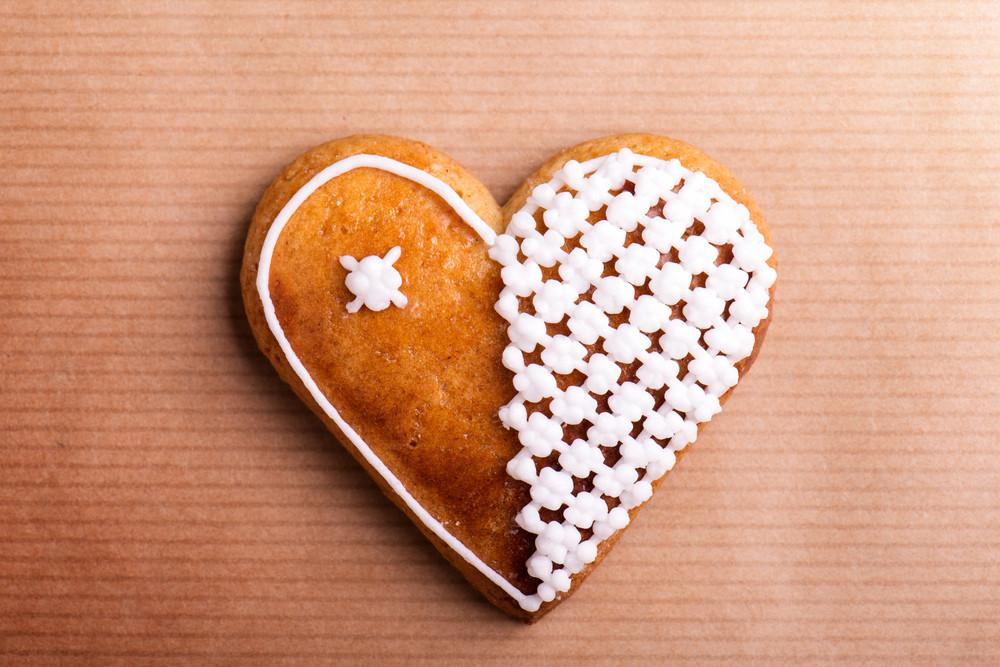 Gingerbread heart. Studio shot on paper background.