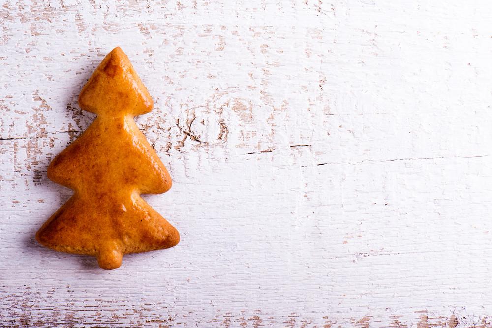 Gingerbread tree. Studio shot on white wooden background.