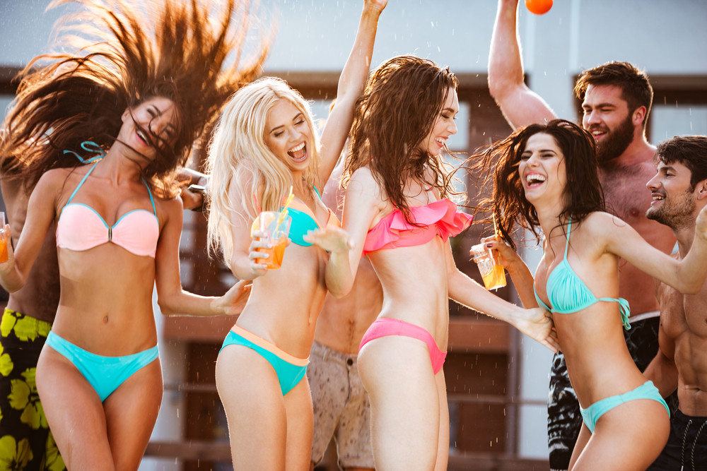 Group of best friends having fun time at swimming pool outdoors