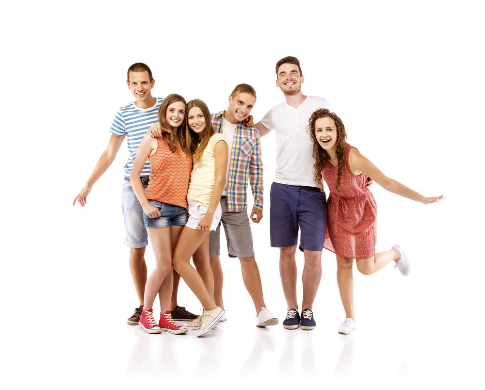 Group of happy young teenager students standing, isolated on white background. Best friends