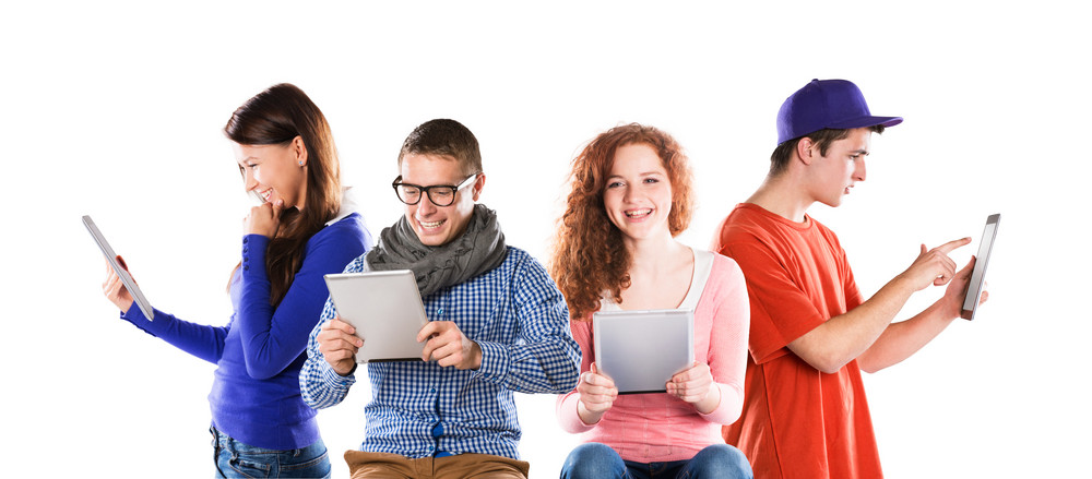 Group of young people with pc tablet, isolated on white background