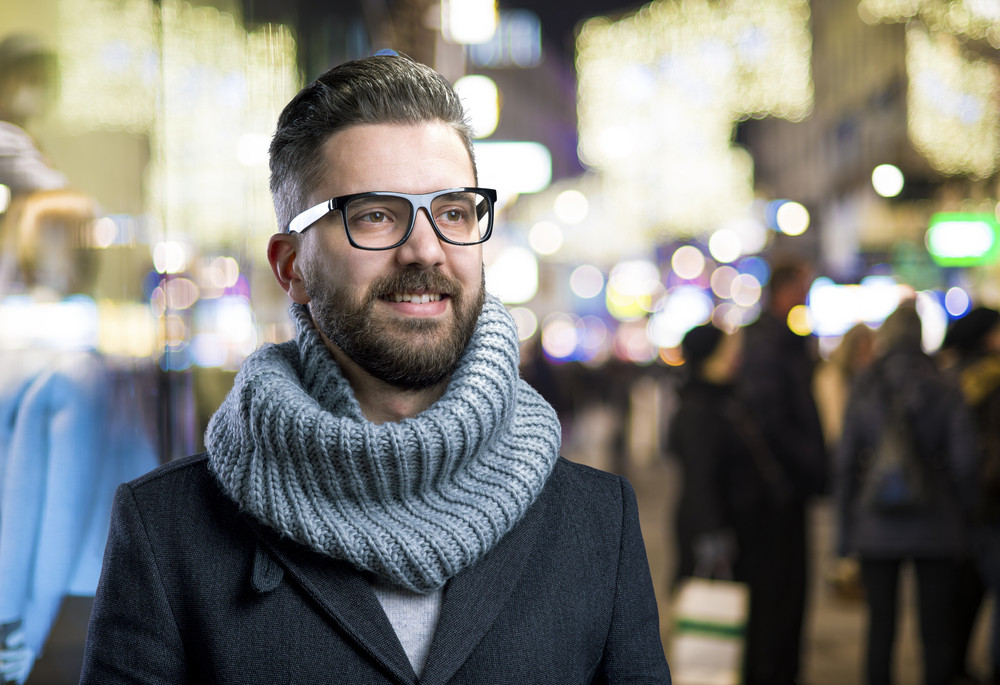 Handsome young hipster outside in the night city